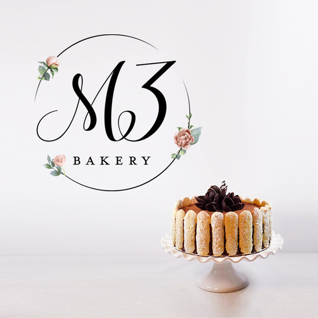 The Me3 Bakery logo is embellished with delicate flowers to represent the hand-crafted chocolate flower arrangements decorating her cakes.