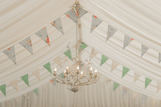 Dotty Daisies handmade doube sided bunting mix & match random coloours in a marquee for weddings and parties