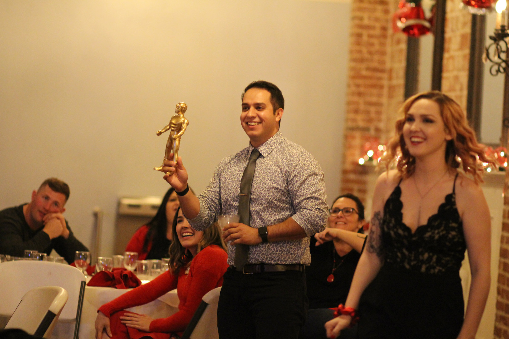 Giving out the Stormwater Superhero Award at our Holiday Party