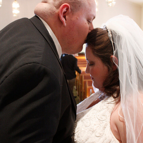 A groom kisses his bride after an emotional ceremony