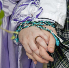 Clasped hands after a handfasting