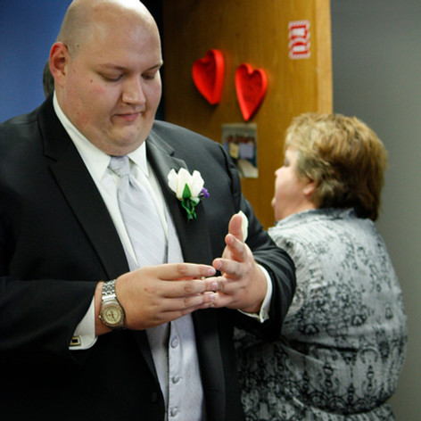 A groom testing his ring before the ceremony