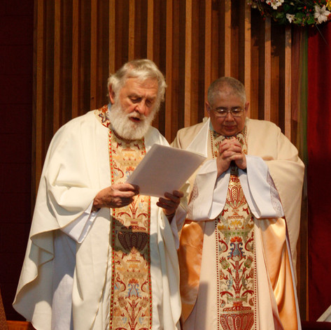 Two Catholic Priests say a prayer over a wedding ceremony