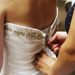 Buttoning up a brides dress
