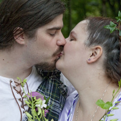 A blissful kiss after a handfasting ceremony