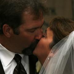 A groom kisses his bride