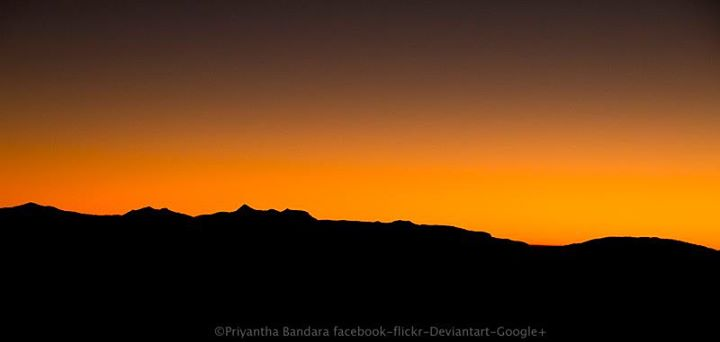 Line of light____The skyline view from Adams Peak, just a moment before the sun comes up