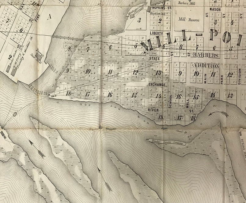 This is a detail photograph of a black and white map, showing Eastman Island and the Grand River, with Blendon Lumber Company located on the north part of the island.