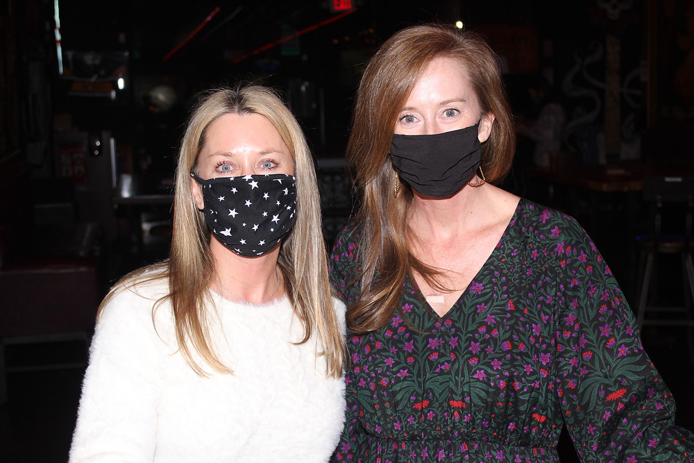Jennifer Ison and Chrissy Kincheloe stand side by side, smiling at the camera underneath their masks