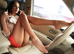 Sexy slim girl sits in car. Very short skirt without panties. Long legs. Beauty urban photo