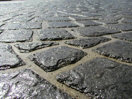 What is decorative concrete, and how does it increase your home or business' curb appeal?