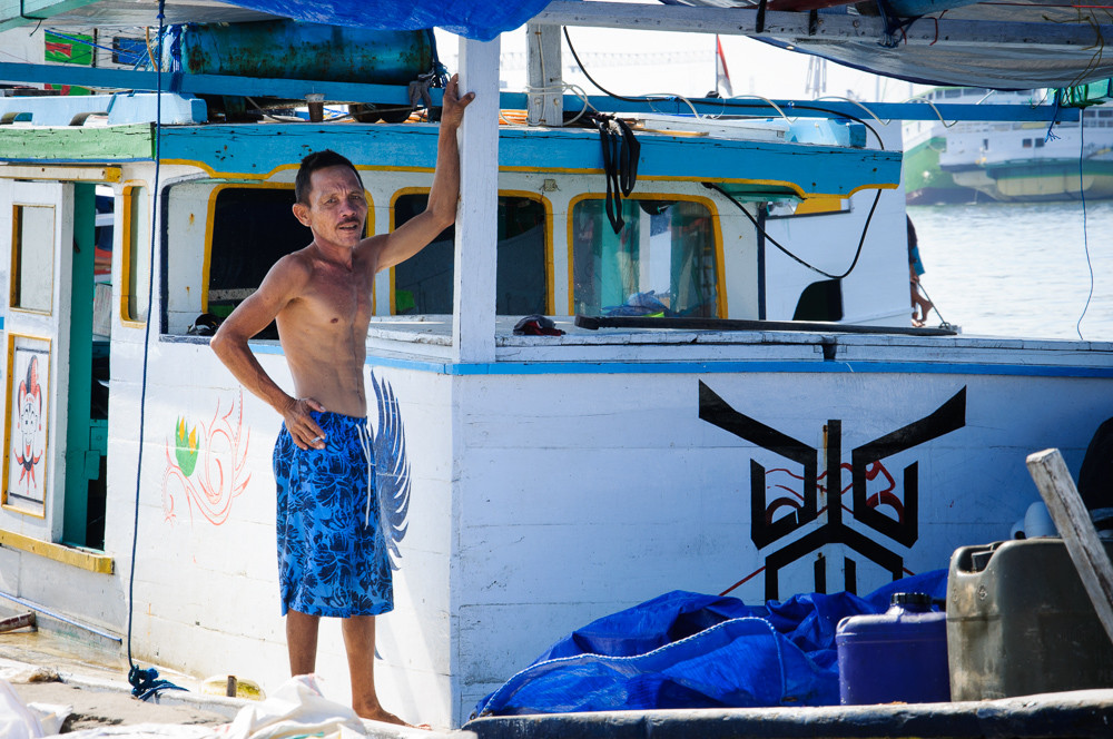 A man is posing on his boat in Makassar, South Sulawesi, Indonesia.