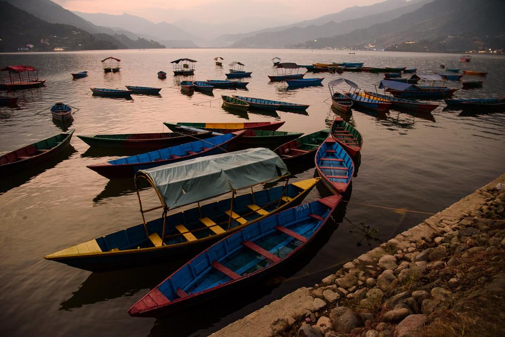 Boats at Phewa Lake at sunrise, Pokhara.