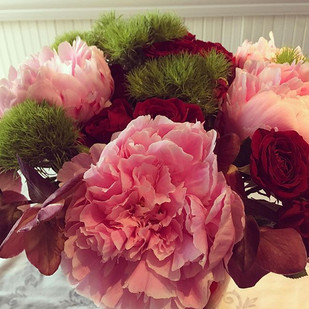 Peonies and spray roses