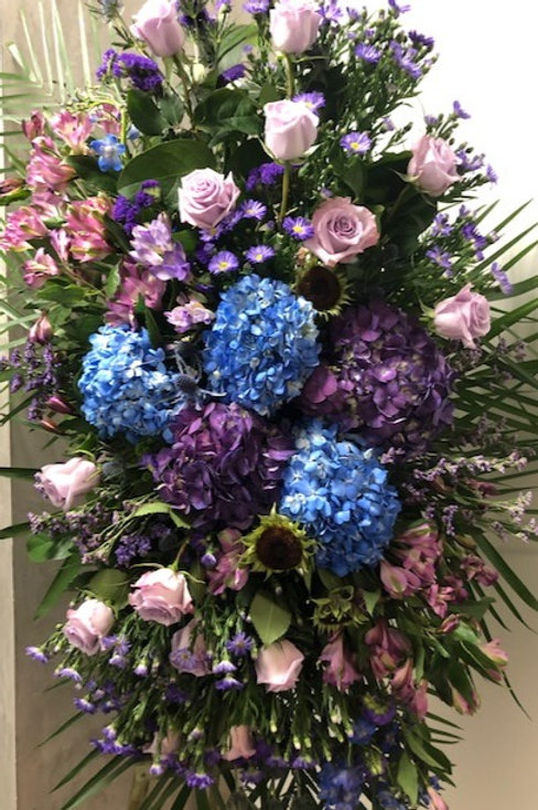 A funeral spray in blues and lavenders