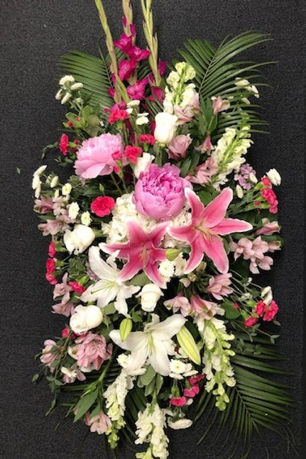 Funeral flowers on an easel