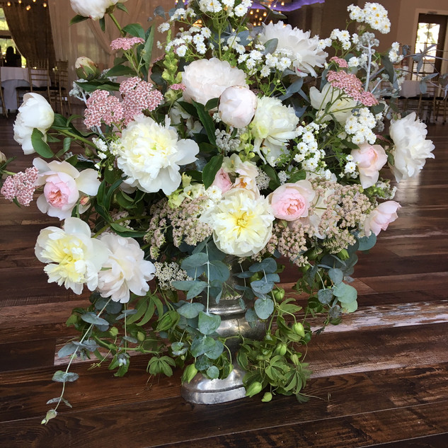Entry table arrangement with peonies