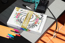 mockup-of-a-hardcover-book-placed-by-some-markers-and-a-vintage-camera-33903