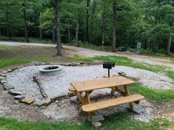 Fire pit area with charcoal grill