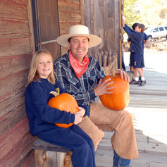 Jack with kids and the pumpkin at TMR