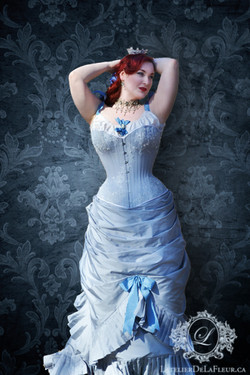 Pale blue Victorian corsetted gown