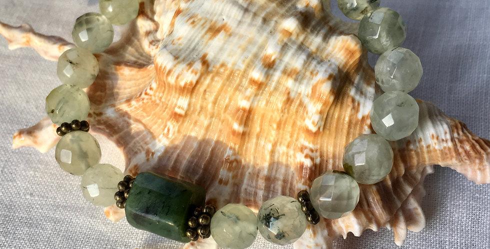 Prehnite and Nephrite jade beaded bracelet shown on a shell.