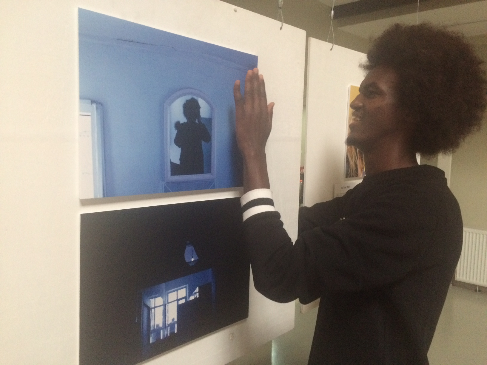 putting up the photographs