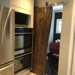13- Sliding Maple Stained Walnut Door
