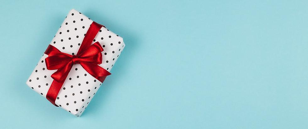 116685148-gift-box-wrapped-black-polka-d