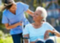 Caregiver-Senior-Black-Outside-Wheelchai