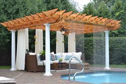cedar pergola with rain fall