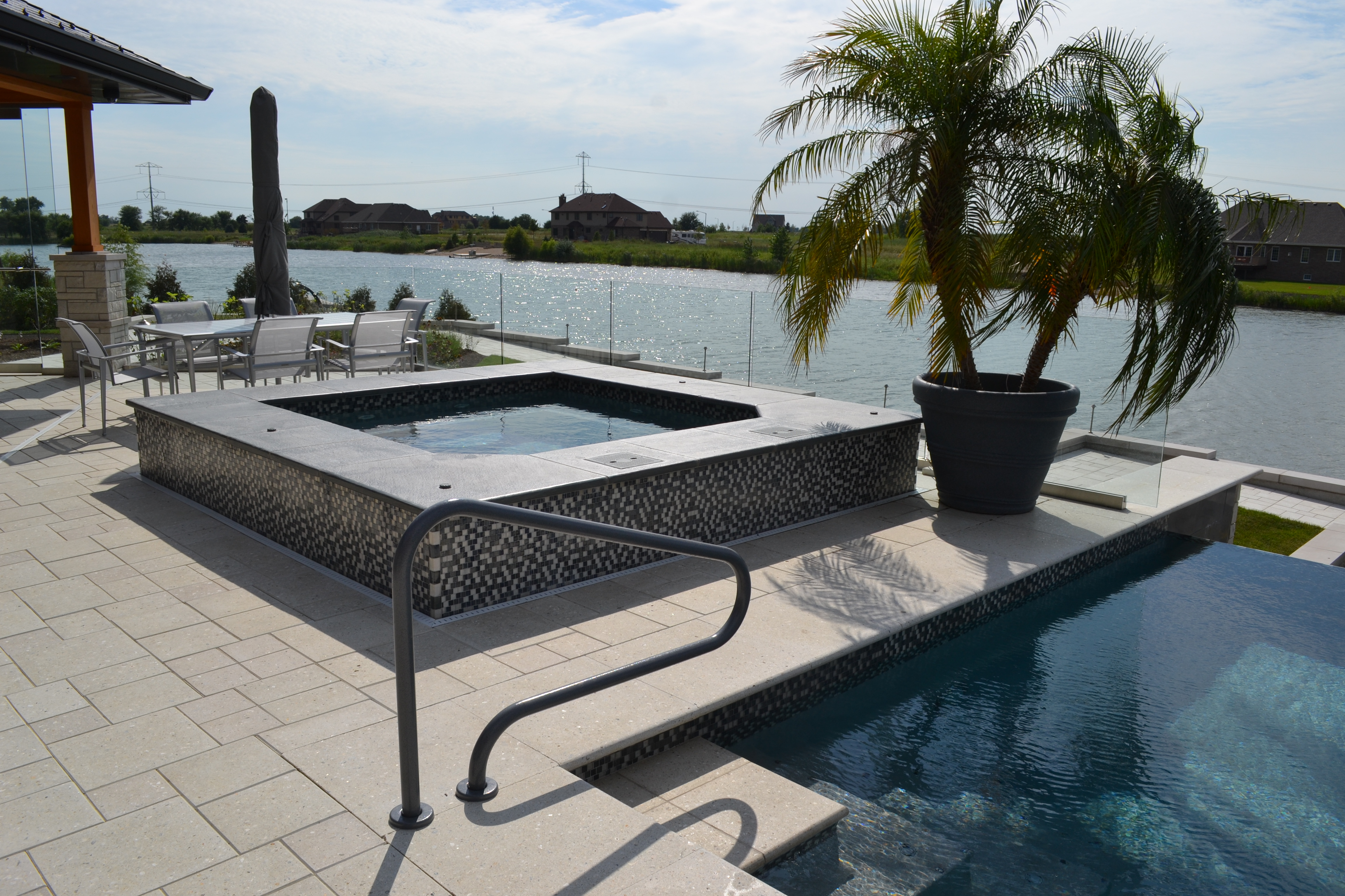 gunite spa with glass tile builder