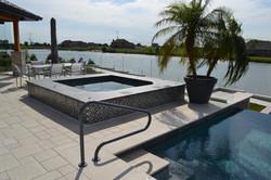 gunite spa with glass tile builder