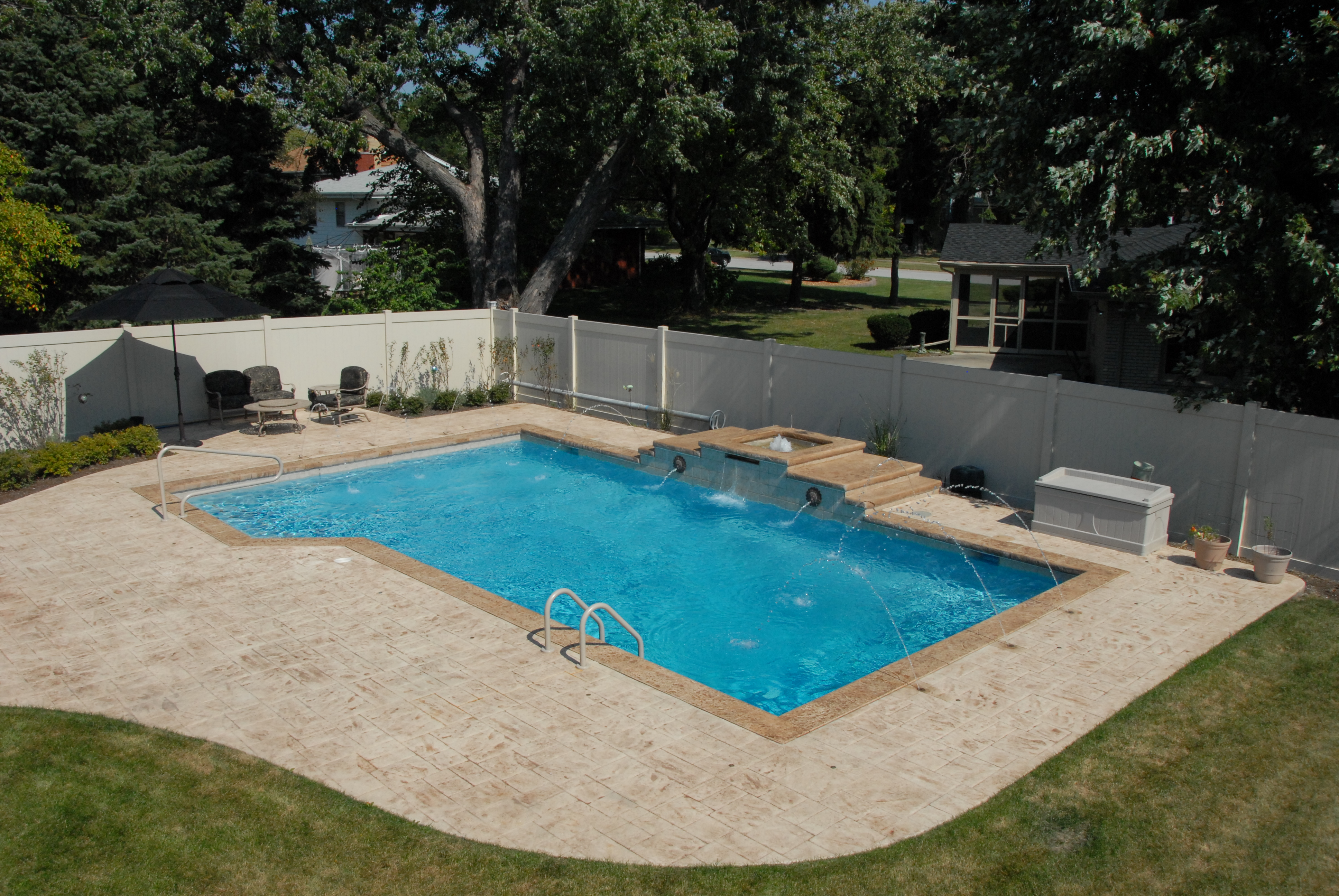 gunite in ground pool with fountain