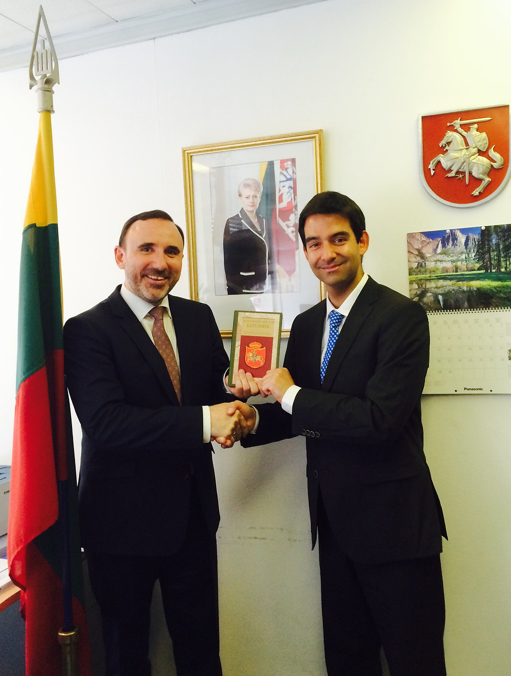 HE Dr. Arūnas Gelūnas (left) presents a book on the history of Lithuania to Mr. Hrishikesa Madhvani (right)