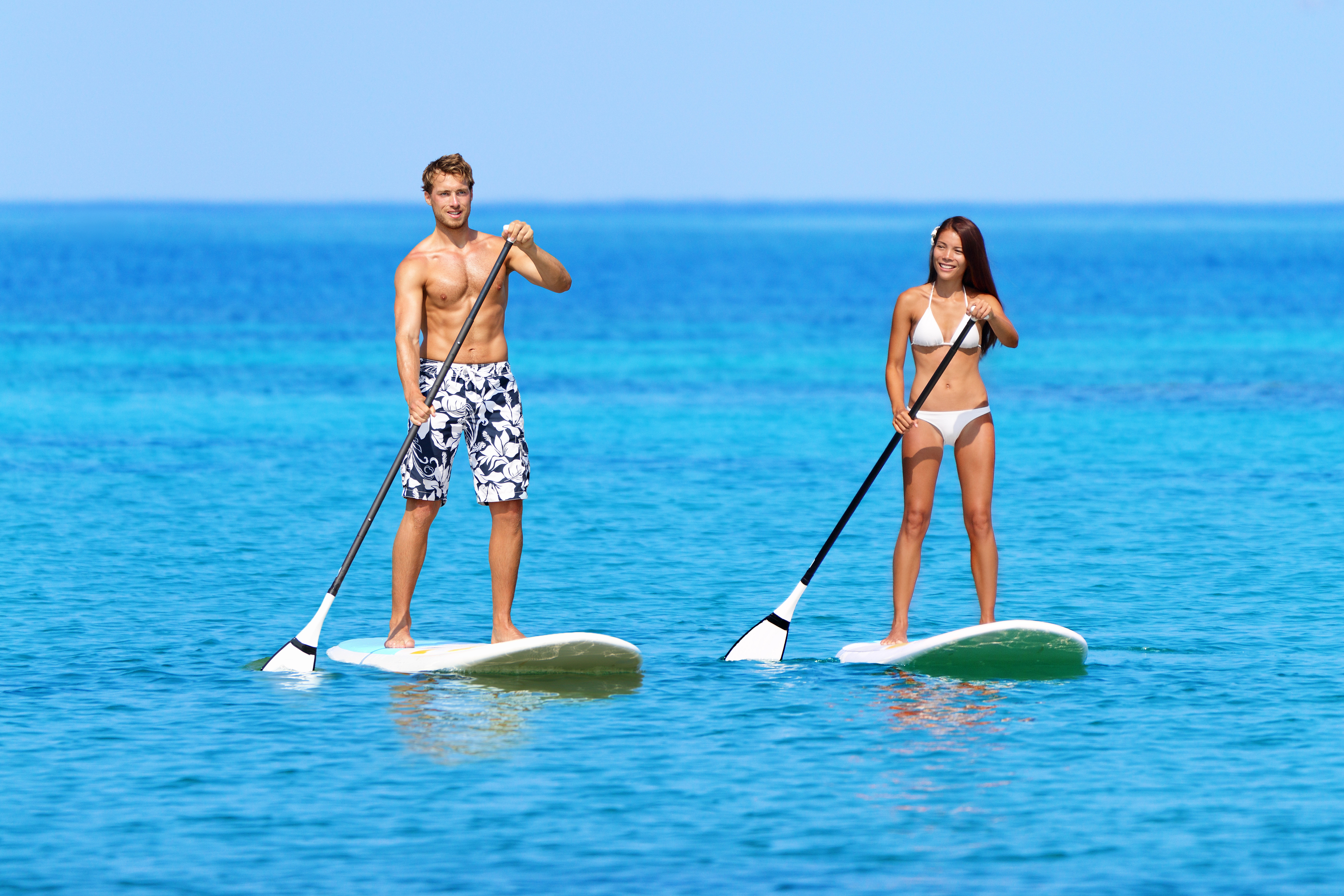 Stand up paddleboarding beach people on stand up paddle board, SUP surfboard sur
