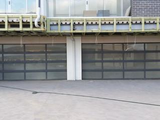 Tempered glass garage doors with opener