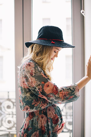 pregnant-woman-in-floral-long-sleeved-dr