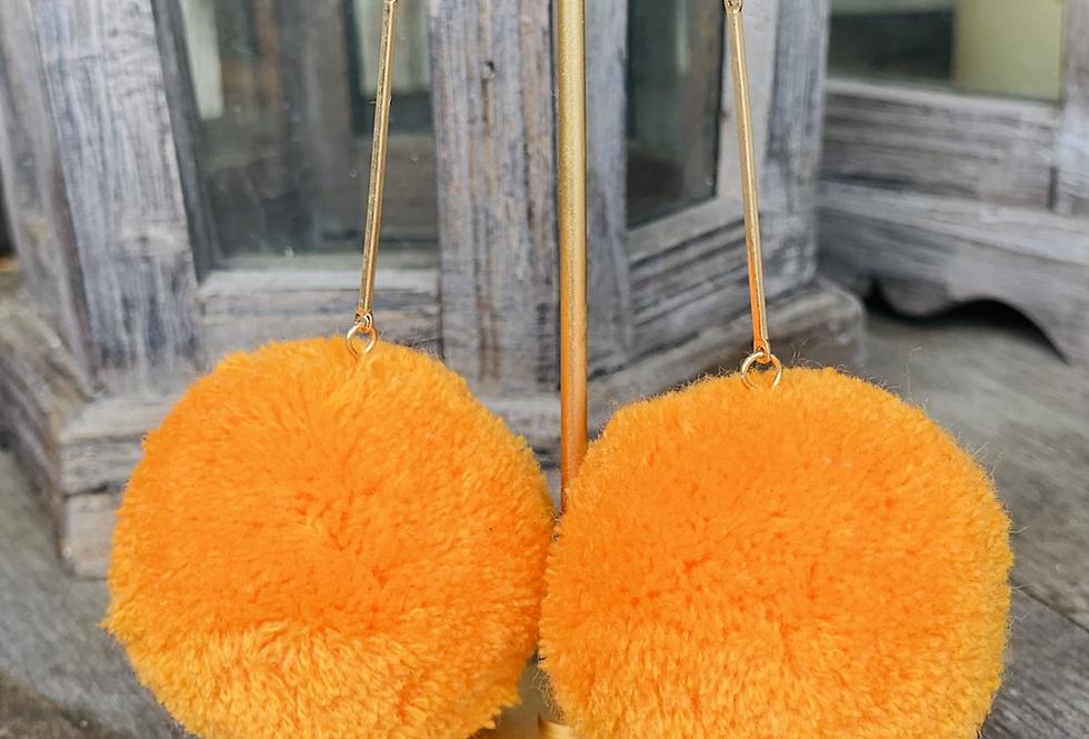 Statement Maker Pom Pom Earrings in Orange