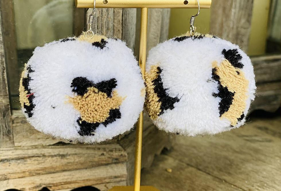 Statement Maker Pom Pom Earrings in White Cheetah