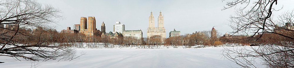 Central Park lake (frozen) in January 2014; looking west to San Remo (tallest twin structures)