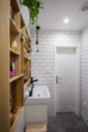 interior design czech prague white bathroom gray hexagon porcelain tiles hygge nordic scandi black tap faucet wooden accessories subway tiles
