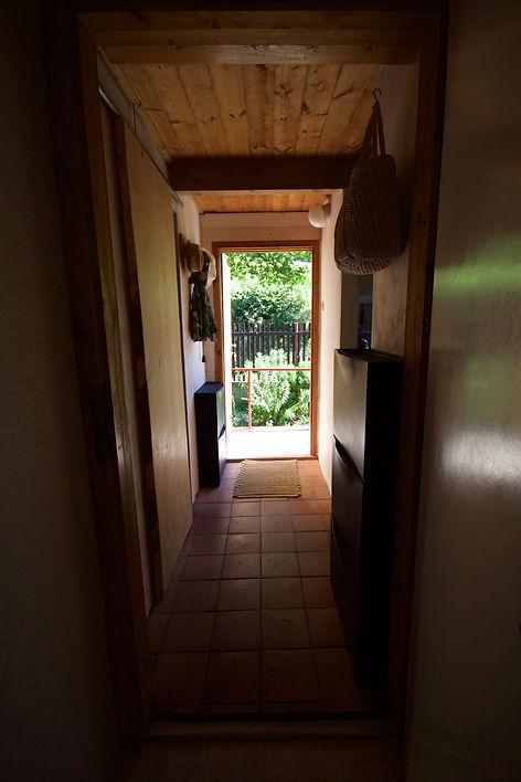 RabunaDesign interior design Prague wooden cottage summer house hallway brick tiles corridor cabin Czech rustic