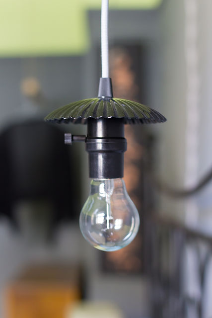 interior design Prague Czech bedside lamp bare bulb black dark interior