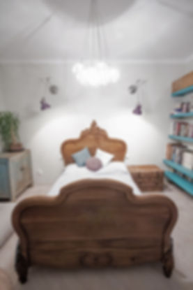 bedroom interior design czech prague antique vintage bed ecelctic hygge purple teal wooden