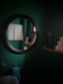 interior design Prague Czech restroom powder room toilet wcblack round mirror dark green emerald