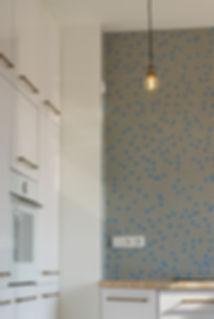 interior design czech prague white kitchen brass industrial light penny tiles blue mosaic end grain wood worktop