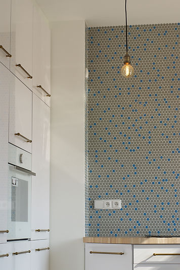 interior design czech prague white kitchen brass industrial light penny tiles blue mosaic end grain wood worktop