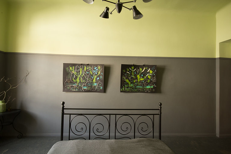 interior design Prague Czech bedroom dark interior chartreuse art paintig