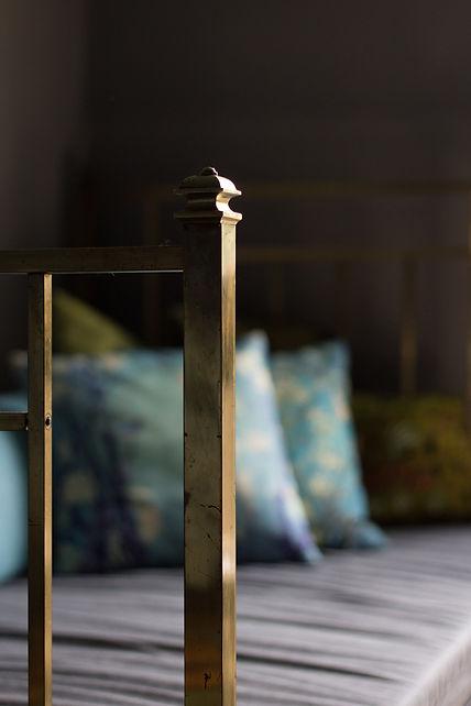 interior design Prague Czech brass bed detail dark interior decadent